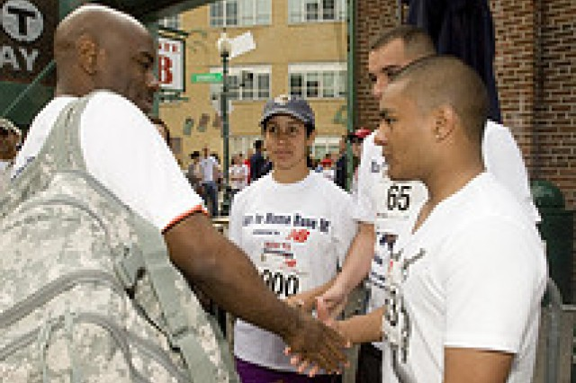 Command Sgt. Maj. Earl Allen, talks to Soldiers from Human Research and Development Detachment from Natick, Mass., as they get ready to run the Race to Home Base 9K.