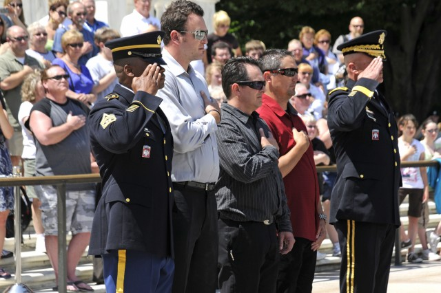 Representatives from the Oakley eyewear company, Maj. Gen. Karl Horst, commander of  Joint Force Headquarters - National Capital Region and The U. S. Army Military District of Washington and Command Sgt. Major Michael Williams, Command Sgt. Major of Joint Force Headquarters -National Capital Region and The U. S. Army Military District of Washington pay tribute during the playing of the National Anthem at the Tomb of the Unknown Soldier at Arlington National Cemetery on May 20, 2010.  *Any references to any non-federal entity or private corporation does not constitute an endorsement of that entity by Joint Force Headquarters-National Capital Region and The U.S. Army Military District of Washington or The U.S. Army.