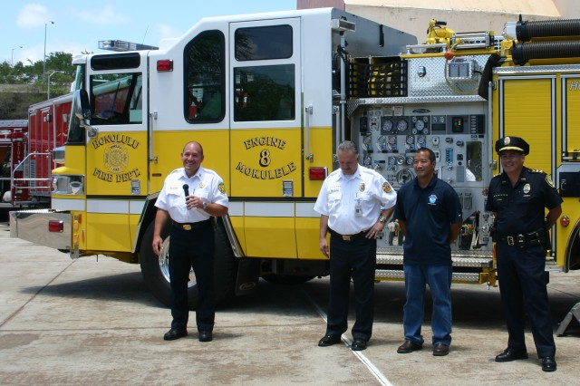 HONOLULU - (From left to right) Chief Kenneth Silva, Honolulu Fire Department, along with Fire Chief Glenn de Laura, Federal Fire Department; Ray Tanabe, National Weather Service; and Capt. Terry Kong, Honolulu Police Department, stand in front of Engine 8 from the Mokulele Fire Station during the 3rd Annual Wildfire media event, May 13.
