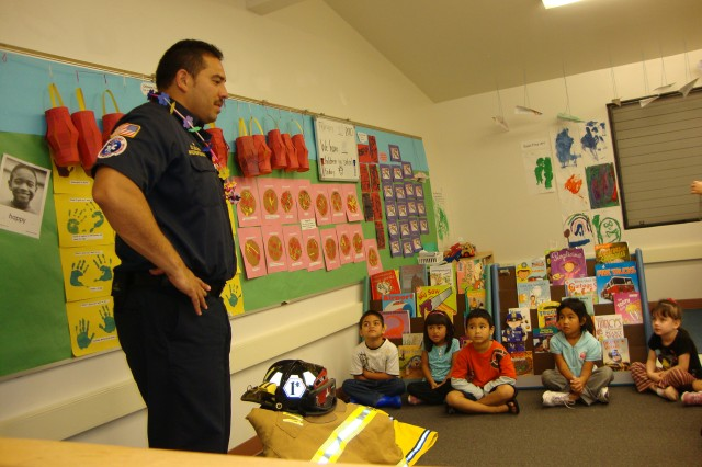 POHAKULOA TRAINING AREA, Hawaii - Firefighter Coloma shares fire safety tips with students at Mountain View Elementary during a share and tell class. Coloma, U.S. Army Garrison-Pohakuloa, has been named the Installation Management Command-Pacific's 2009 Firefighter of the  Year.
