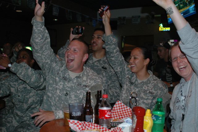 SCHOFIELD BARRACKS, Hawaii - Soldiers and patrons cheer as they light up the Kolekole Bar and Grill with their cell phones to show their support for the contestants of the Battle of the Bands. The winning band Delayed Resistance, will perform for the Tropics Recreational Center reopening and the Fourth of July Spectacular.