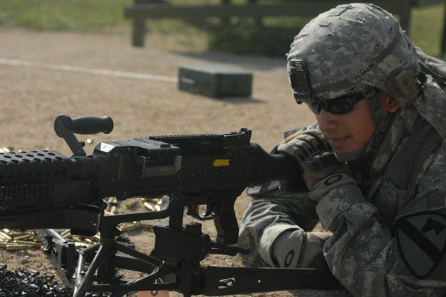 FORT HOOD, Texas - Bucaramanga, Columbia native, Spc. James Davis, a scout assigned to the 1st Squadron, 7th Cavalry Regiment, 1st Brigade Combat Team, 1st Cavalry Division, prepares to fire his M240B at the machine gun range, here, May 18.