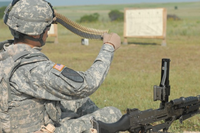 "FORT HOOD, Texas - Jacksonville, Fla. native, Spc. Aaron Falk, a scout assigned to the 1st Squadron, 7th Cavalry Regiment, 1st Brigade Combat Team, 1st Cavalry Division, counts rounds to prepare for firing his M240B, May 18. ""Garryowen"" troops attended the range to ensure weapons were mission capable and maintain mission readiness."