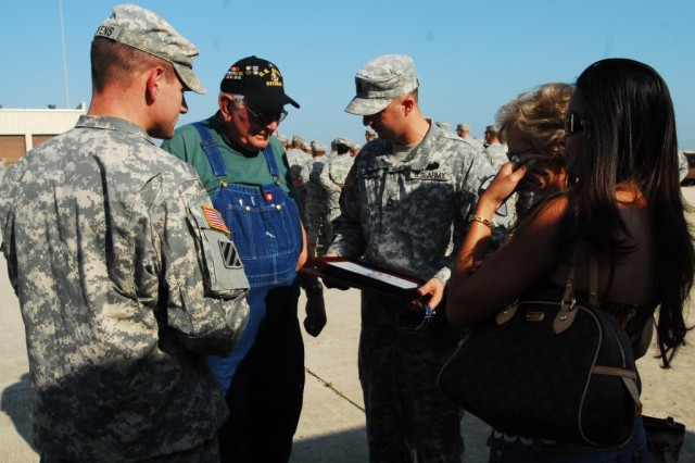 FORT HOOD, Texas-Sgt. 1st Class Cheyenne Barber (center), a platoon sergeant with the 2nd Special Troops Battalion, 2nd Brigade Combat Team, 1st Cavalry Division, looks over the certificates presented to his grandpa, Dean Scantling, during a ceremony on Fort Hood, Texas, May 17.