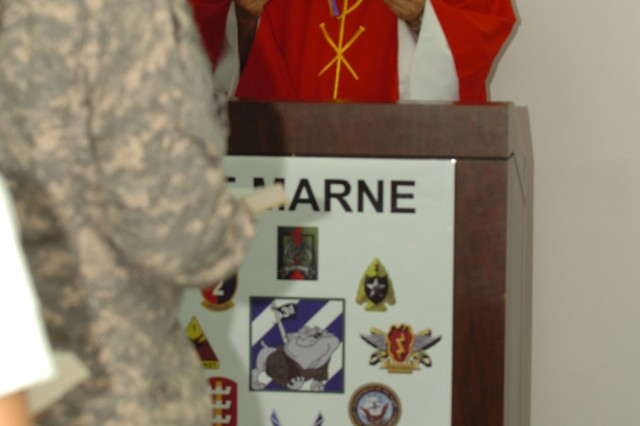 Capt. Arkadiusz Ochalek, a chaplain with Division Special Troops Battaltion, 3rd Infantry Division, speaks at a church service to Soldiers, May 22, at Contingency Operating Base Speicher.