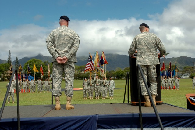 "SCHOFIELD BARRACKS, Hawaii -- Maj. Gen. Bernard S. Champoux, commanding general, 25th Infantry Division (right), speaks to an audience of Soldiers, guests, and family members of Brig. Gen. James C. Nixon, the outgoing deputy commanding general - operations, 25th Inf. Div., during a ""Flying V"" ceremony at Sills, Field, here, May 25. The ceremony offered well-wishers the opportunity to bid Nixon farewell as he departs the division. Nixon planned and helped to execute the operations for three brigades in three provinces during the division's previous deployment to Iraq. (U.S. Army photo by Spc. Jesus J. Aranda, 25th Infantry Division Public Affairs Office)"