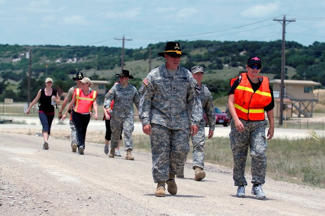 FORT HOOD, Texas-Spouses and their troopers assigned to the 1st Squadron, 9th Cavalry Regiment, 4th Brigade Combat Team, 1st Cavalry Division participate in a 1.3 mile road march during the Spouse Spur Ride, May 22.