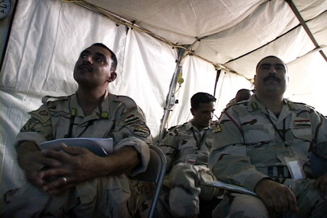 Medical personnel from the Iraqi Army's 14th Division listen during a two-day preventive medicine course held on Contingency Operating Base Basra, Iraq, hosted by 17th Fires Brigade medical staff.