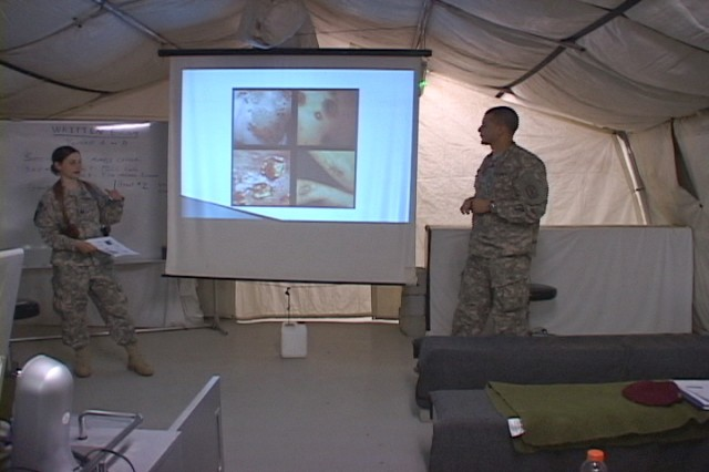 Capt. Susan Mosier, Headquarters and Headquarters Battery, 17th Fires Brigade surgeon, teaches a class on sexually-transmitted infections while 2nd Lt. Karim Elymani, HHB, 17th FiB surgeon cell medical operations officer, translates the class for medical personnel from the Iraqi Army's 14th Division during a two-day preventive medicine course held on Contingency Operating Base Basra, Iraq.
