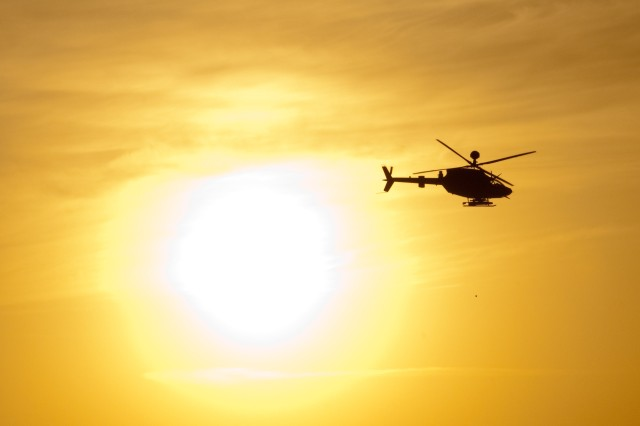 AL ASAD AIR BASE, Iraq - An OH-58D Kiowa Warrior helicopter with Task Force Saber, Combat Aviation Brigade, 1st Infantry Division, flies past the setting sun outside Al Asad Air Base, Iraq, May 21, 2010. The helicopter participated in partnered fire aerial-ground integration training between 82nd Airborne Division and 7th Iraqi Army Division. (U.S. Army photo by Sgt. Michael J. MacLeod, 1/82 AAB, USD-C)