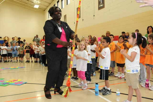 Dr. Wanda Bradley, Pierce Elementary principal and Gulfport, Miss., native, had some fun with her students during the opening ceremony for Pierce's Field Day on May 20-21. During the event, Bradley was delighted to have the assistance of several 3d Sustainment Command (Expeditionary) Soldiers.  Bradley said she was very appreciative of the 3d ESC's sponsorship to her school and the help they've provided in past months. (U.S. Army photo by Sgt. Michael Behlin)