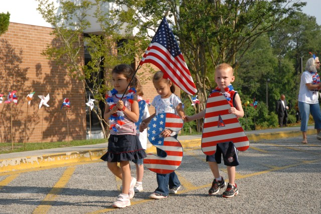 Pre-kindergarten students represent the United States in the International Day parade.