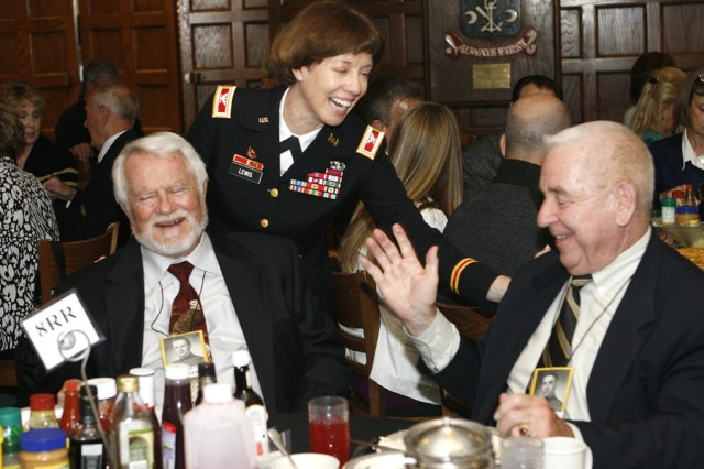 Col. Debra Lewis talks with some Class of 1950 graduates prior to her retirement ceremony inside Washington Hall at West Point, N.Y., on May 20. Photo by Mike Strasser, West Point Public Affairs
