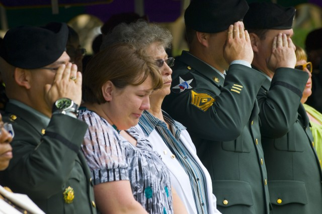 Mrs. Daphne Hagerty, wife of Maj. Scott A. Hagerty, remembers her husband alongside the fallen Soldier's mother, Mrs Shirley Hagerty, while civilians and Soldiers salute and remember our Soldier's ultimate sacrifice at the U.S. Army Civil Affairs and Psychological Operations Command (Airborne)'s memorial service on May 25, here at Fort Bragg, N.C.  The command holds the memorial yearly at Fort Bragg to honor its fallen Soldiers and their families.