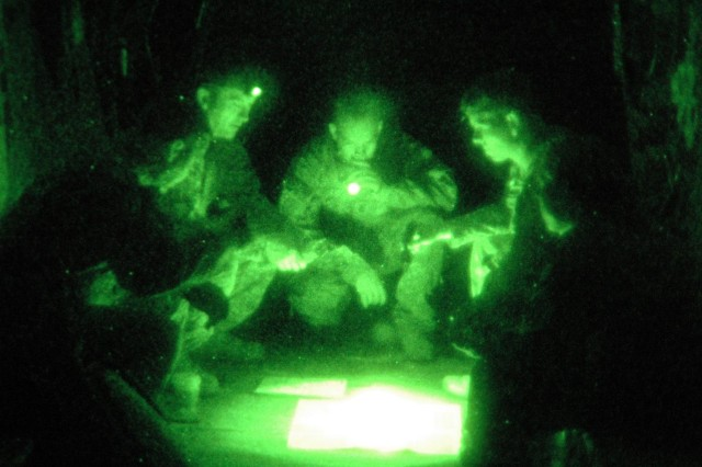 Major Whitney Gardner, CH-47D Chinook helicopter pilot and operations officer, 3rd Battalion, 25th General Support Aviation Battalion, Task Force Hammerhead, leads his crew during a review of the route for a tripartite air assault mission during preparation at Contingency Operating Base Speicher, near Tikrit, Iraq, April 24.   (Photo by:  Sgt. 1st Class Tyrone C. Marshall, 25th Combat Aviation Brigade Public Affairs)