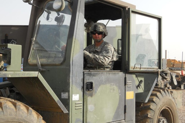 Cpl. Garrett Huitt, Battery B, 3rd Battalion, 29th Field Artillery Regiment, a native of Big Spring, Texas, works diligently as the primary forklift operator to build upon the existing security, safety measures and living conditions at Joint Security Station Jenkins, Iraq, May 6, 2010.