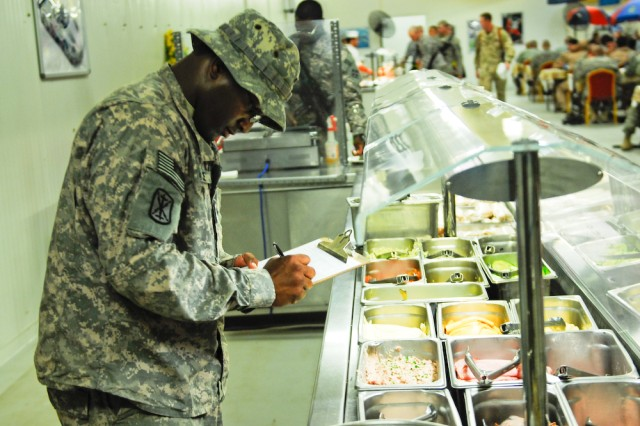 Spc. Charles McGee Jr., Headquarters and Headquarters Company, 308th Brigade Support Battalion food specialist, verifies the food at the Thunderbolt Dining Facility on Contingency Operating Base Basra, Iraq, is being served at the proper temperatures, May 20, 2010.