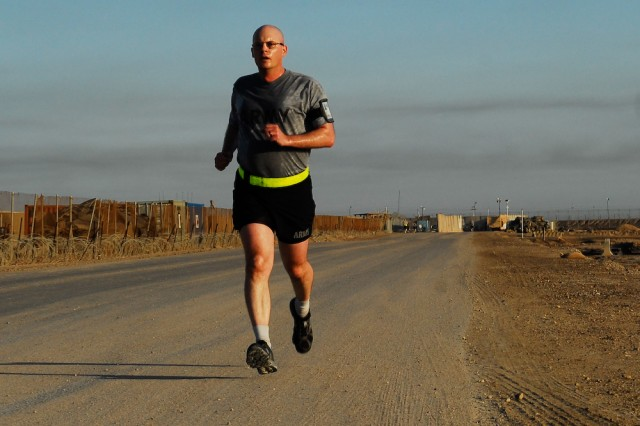 Lt. Col. Michael Phillips, commander, 308th Brigade Support Battalion and a native of Monaca, Pa., runs at Contingency Operating Base Basra, Iraq, as he takes the final steps of his twenty-year journey toward achieving his goal to run 10,000 miles, May 4, 2010.