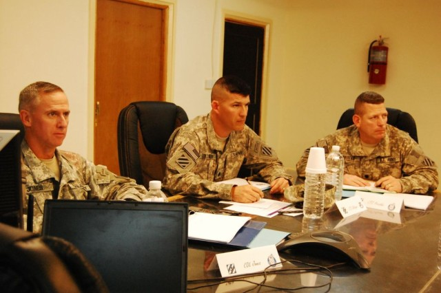 Col. Peter Jones, commander, 3rd Heavy Brigade Combat Team, 3rd Infantry Division; Lt. Col. Todd Zollinger, commander, 3rd Brigade Special Troops Battalion, and Lt. Col. David Priatko listen to guidance from  Brig. Gen. Randal Dragon, deputy commanding general for support, 1st Infantry Division, at the Provincial Reconstruction Team conference May 14, 2010, at Contingency Operating Site Kalsu, Iraq.