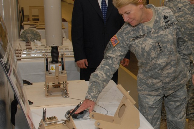 Jason Klimczak, mechanical engineer, discusses the capabilities of the antenna pull down device with Gen. Ann E. Dunwoody, Army Materiel Command commanding general and Col.  Charles Gibson, depot commander. Dunwoody led a team of AMC senior personnel here to evaluate depot operations.