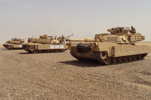 Soldiers from Company B, 2nd Battalion, 69th Armor Regiment, 3rd Heavy Brigade Combat Team, 3rd Infantry Division, conduct the tank crew gunnery skills test, April 29 - May 8, 2010, at the Besmaya Range Complex, Diyala Province, Iraq.