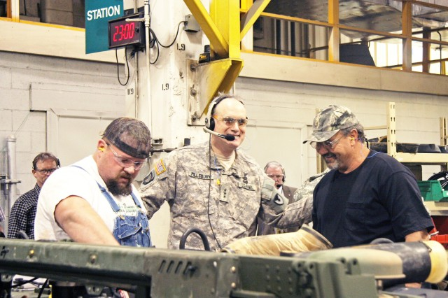 Lt. Gen. James H. Pillsbury, Army Materiel Command deputy commander, talks with mechanics on the HMMWV production line during his visit to RRAD.
