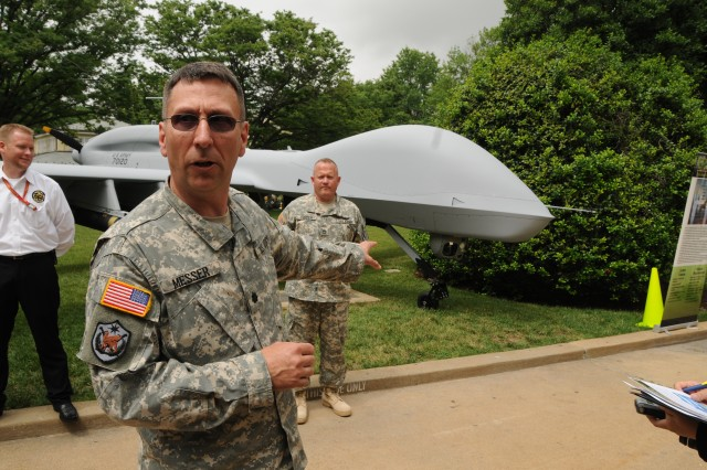Lt. Col. Kevin Messer, product manager for medium altitude endurance systems in the Army Unmanned Aircraft Systems Project Office, spoke May 25 about the capabilities of the MQ-1C Extended Range Multi-Purpose UAS on display in the courtyard of the Pentagon. The Army recently passed 1 million hours of flight time on its unmanned aircraft.