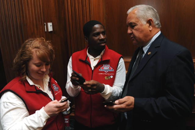 Rep. Silvestre Reyes, of Texas' 16th Congressional District, discusses tweeting with Anthony and Megan, two members of the Army Teen Panel.
