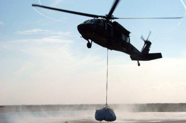 A UH-60 Blackhawk helicopter belonging to the 1/244th Assault Helicopter Battalion, State Aviation Command, Louisiana Army National Guard, in Hammond, La., performs sling-load operations, May 11, 2010, in support of the state of Louisiana's response to the Deepwater Horizon.