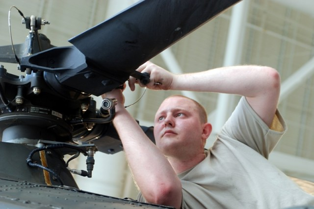 Staff Sgt. Aaron L. Mahnke, an aviation mechanic with the State Aviation Command, Louisiana Army National Guard, in Hammond, La., makes a necessary repair to the rotor assembly of a UH-60 Blackhawk helicopter prior to flight operations, May 19, 2010. The State Aviation Command has deployed critical aviation assets to the state of Louisiana's fight to protect critical waters and marshes from oil spewing from the Deepwater Horizon oil well that exploded on April 20, 2010.
