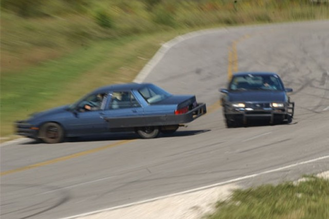 """Student drivers in the Protective Services Training and Anti-terrorism Evasive Driving courses at the U.S. Army Military Police School at Fort Leonard Wood, Mo., learn to reverse at high speeds. Each student in the driving courses is assigned a """"clunker"""" to practice ramming into other cars."""