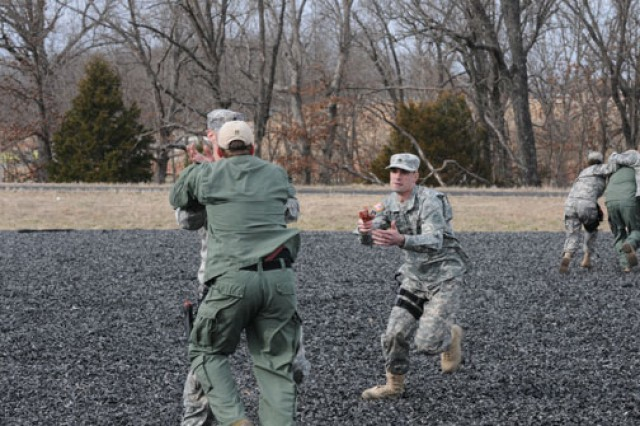 """Special agents neutralize a threat during an """"attack on principal"""" drill while receiving extensive training at the Protective Services Training Course."""