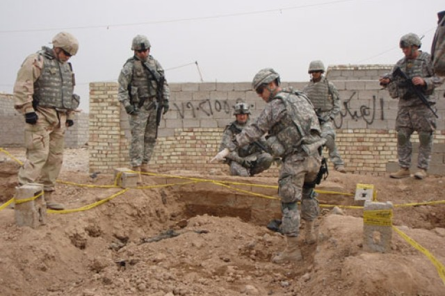Special agents in Iraq work with deployed Soldiers to process a mass gravesite left behind by Saddam Hussein's regime.