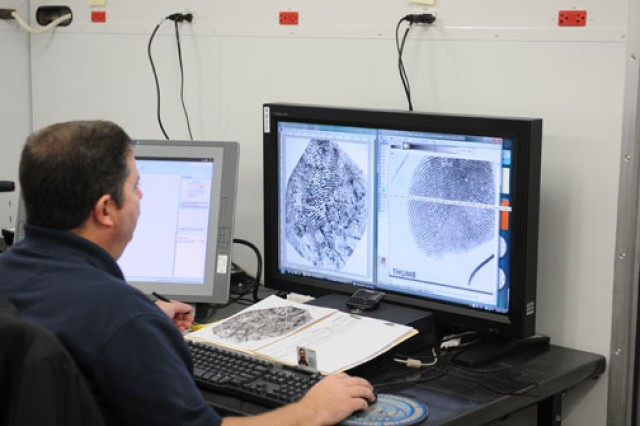 Tommy Monday, a latent print examiner with the Expeditionary Forensics Division at the U.S. Army Criminal Investigation Laboratory at Fort Gillem, Ga., is preparing to deploy to Afghanistan with a joint expeditionary forensics facility.