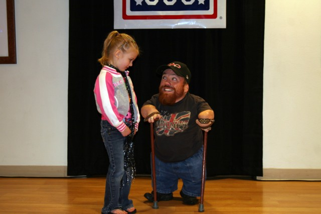 FORT CARSON, Colo.---Two Feet Fred talks with one of the audience members at the Fort Carson USO May 14.