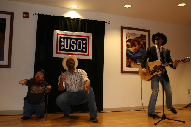 FORT CARSON, Colo.---from left, Two Feet Fred, Cowboy Troy and John Rich entertain the troops and their Families at the Fort Carson USO May 14.