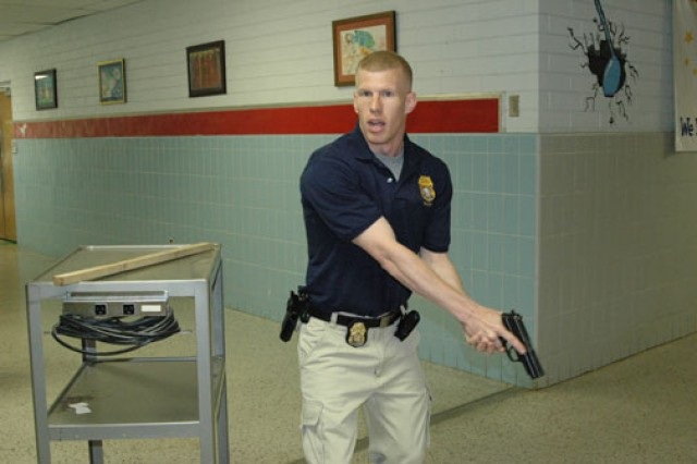 A CID special agent participates in an active-shooter exercise at an on-post facility. CID agents continually train for any contingency that may arise in the course of their duties.