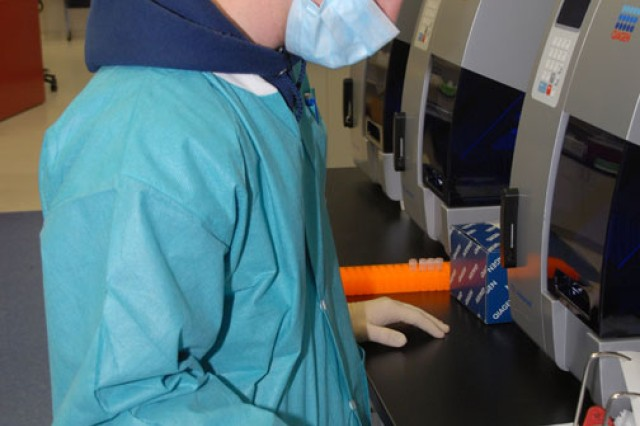 DNA examiner Phil Nace processes a DNA sample at the U.S. Army Criminal Investigation Laboratory at Fort Gillem, Ga. Scientists need only a sample about the size of a pencil point to obtain useable DNA.