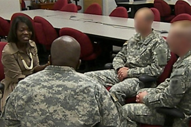 Donna Ferguson, branch chief for the Critical Incident Peer Support course,  counsels a group of military police who were involved in a traumatic incident. The Critical Incident Peer Support course is designed to help military police and special agents cope with the psychological stress they are sometimes exposed to in their occupation. (Faces and identifiers have been blurred to protect the privacy of the Soldiers.)
