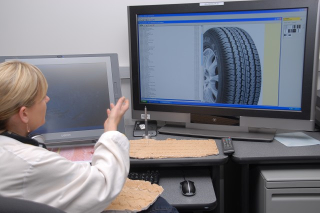 Forensic scientist Amanda Atkins analyzes the casting of a tire impression and compares the sample to a tire database for identification at the U.S. Army Criminal Investigation Laboratory at Fort Gillem, Ga.