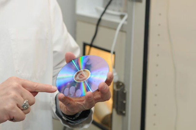 A CD after cyanoarcrylate treatment, which plasticizes the fingerprints and prevents their removal.