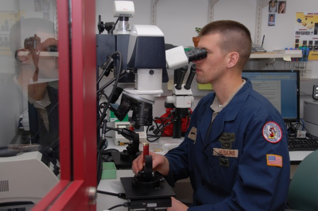 Former Soldier Brandon Huskins, now a student at the Firearms Branch at USACIL, practices identifying ammunition rounds.
