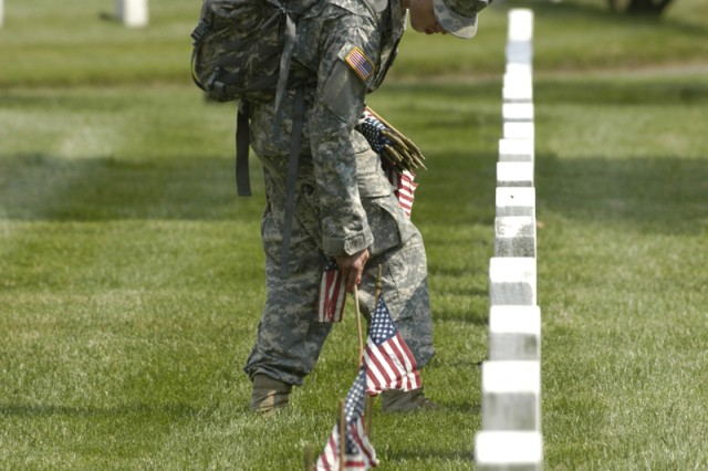 Old Guard Soldiers perform 'Flags In'