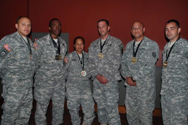Medal winners from left are Capt. Juan Guerrero, Staff Sgt. Paul Roberts, Sgt. Lilina Benning, Staff Sgt. Robert Price, Spc. Sergio Lara and Spc. Shawn Porter.