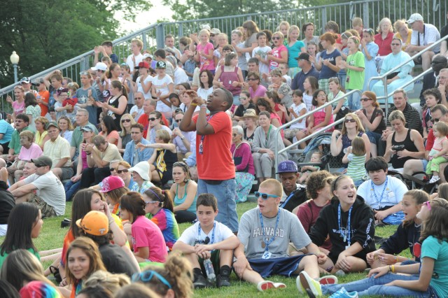 A student dances to the music as Downrange performs at the May 26, 2010 Twilight Tattoo. Over 2,500 people attended the performance.