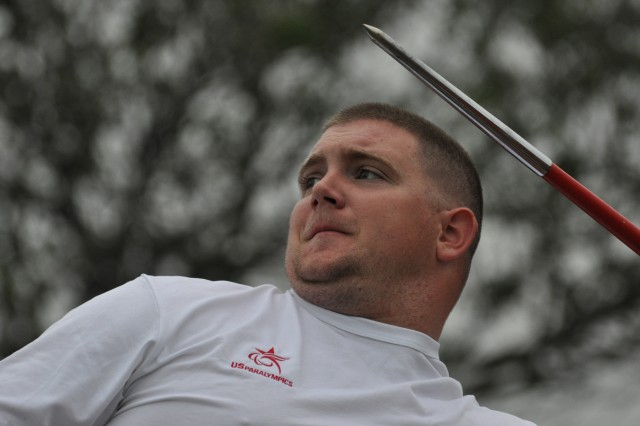 Air Force Senior Airman Colton Read aims a javelin, during a quarterly WTB adaptive sports competition at the FSH archery field, May 25.