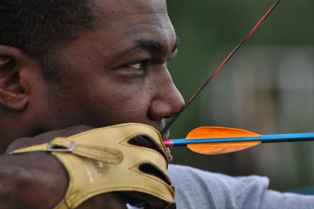 Sgt. 1st Class Kevin Majors focuses on his target during the archery portion of a quarterly WTB adaptive sports competition at the FSH archery field, May 25.