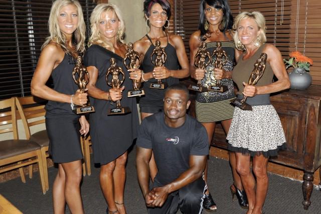 FORT CARSON, Colo.---Members of the team that represented Fort Carson at Saturday's Probody Solutions Southern Colorado and Armed Forces Natural Bodybuilding, Figure and Bikini Championships show off the hardware they won at the event. The winners are from the left, Christina Robertson, Carla Dial, Erica Lenn, Kanina Garner and Debbie Adrig. Pius Agyemang, front, won two first-place awards in his first Colorado event.