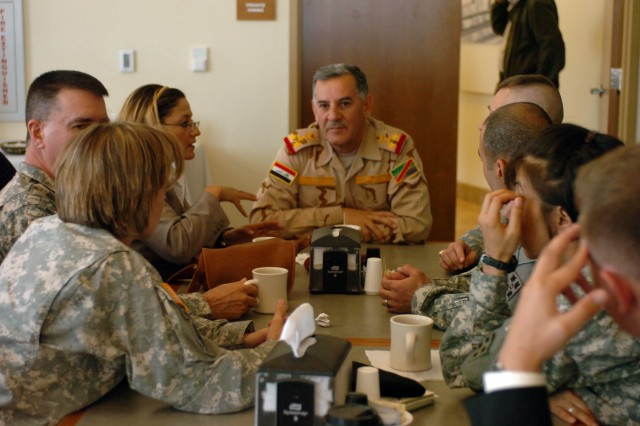 Fort Carson, Colo. - Leaders of the 4th Infantry Division headquarters question staff Brig. Gen. Abdulrahman Handhal Mahdi Alburghif, center, 10th Brigade commander, 3rd Iraqi Army, about the challenges in Iraq that he is currently facing May 9 at Raider Dining Facility. Brig. Gen. James Pasquarette, 4th Inf. Div. deputy commanding general, support, said that being able to meet with the Iraqi officers they will be working with in the U.S. is something he has never seen before.