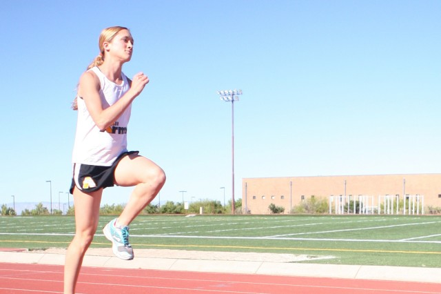 Capt Kelly Calway, World Class Athlete Program participant, practices a jumping drill to enhance her running skills. She will enter the WCAP, track and field section, in August.